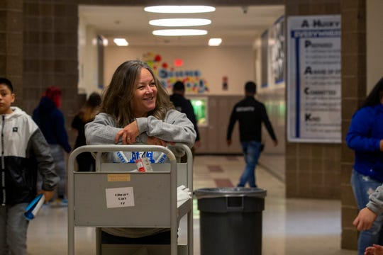 Instructional assistant Debbie Cabello assists students in cleaning out their lockers at Houck Middle School on March 13, 2020, on the last day before Oregon schools close due to coronavirus.