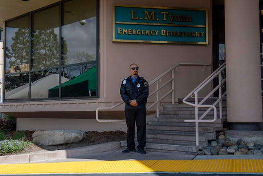 Nick Ruiz a security officer at the Salinas Valley Memorial Hospital stands outside the emergency room directing individuals to the triage tent for possible COVID-19 testing on March 13, 2020.