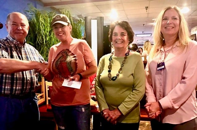 From left: West Angelo Kiwanis Club President Ron Knight presents a donation for $500 to Sonrisas Program Director Megan Kirkwood, who is also a club member as longtime volunteer Nancy Knight and . Looking on are Sonrisas volunteers Nancy Knight, and Michelle Pape.