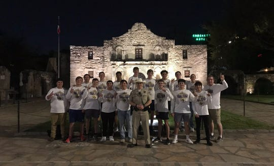 The San Saba High School boys basketball team poses for a shot in front of the Alamo Thursday, March 12, 2020. The team learned earlier Thursday that its UIL State Basketball tournament semifinal game would be postponed until further notice amid fears of COVID-19 pandemic.