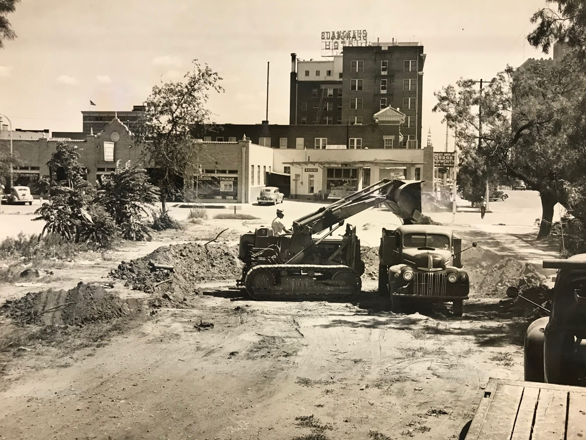 Occupying a central position in the 100 block of South Irving Street, the old San Angelo City Hall building and fire station is seen here between the St. Angelus Hotel and a corner filling station, as workers from Reece Albert dig what will become the basement of the Standard-Times building in the early 1950s.