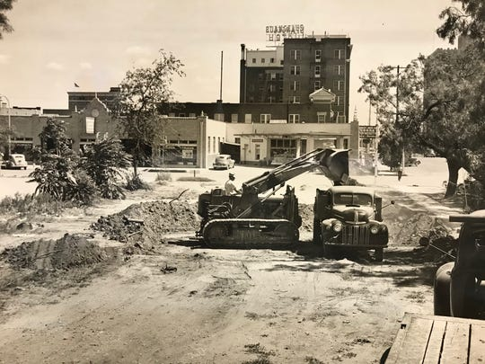 Occupying a central position in the 100 block of South Irving Street, the old San Angelo City Hall and fire station building is seen here between the St. Angelus Hotel and a corner filling station, as workers from Reece Albert dig what will become the basement of the Standard-Times building in the early 1950s. The hotel and City Hall buildings were demolished to make way for the Central National Bank building, which is now home to Wells Fargo Bank.