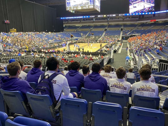 The San Saba High School boys basketball team watches the game action in the Alamodome in San Antonio, Texas, during the UIL State Basketball Tournament Thursday, March 12, 2020. The Armadillos were scheduled to play at 8:30 a.m. Friday, March 13, but after four games were played on Thursday, the UIL suspended the contest until further notice due to concerns over COVID-19.