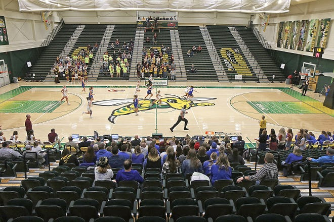 Players from Ethan and Castlewood run the floor during the first day of action at the State Class B girls basketball tournament being played at the Donald E. Young Center in Spearfish, S.D. A proclaimation issued by Gov. Kristi Noem on Thursday, March 12, 2020 limited attendance at tournament games to teams and fans from each competing school and essential personnel. The Ethan-Castlewood game was played before a crowd that took up about 25% of the building's capacity.