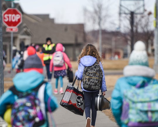Kids are released from school on Friday, March 13, 2020 at Discovery Elementary School in Sioux Falls. Gov. Kristi Noem asked for the state's public schools to close for a week for cleaning due to covid-19.