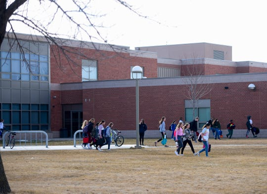 Kids are released from school on Friday, March 13, 2020 at Memorial Middle School in Sioux Falls. Gov. Kristi Noem asked for the state's public schools to close for a week for cleaning due to covid-19.