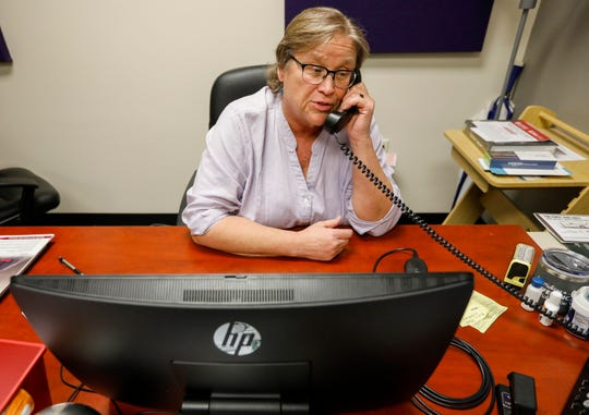 Lynne Meyerkord, director of the AIDS Project of the Ozarks, talks on the phone on Friday, March 13, 2020.