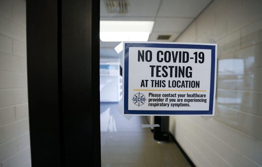 A sing of the door of the Springfield-Greene County Health Department notifying visitors that there is no testing for Covis-19 on the premises on Friday, March 13, 2020.