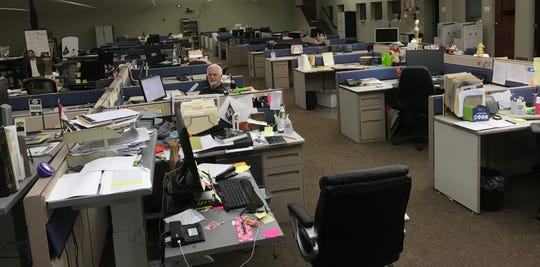Social distancing ... while at work.  (Photo by Lisa Gottman/News-Leader)