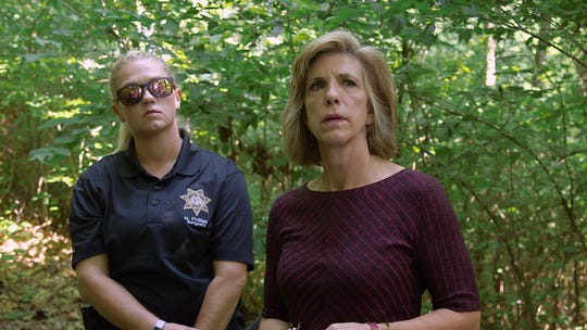 "Former Texas prosecutor Kelly Siegler with Oxygen's ""Cold Justice"" TV show (right) and Lawrence County Sheriff's Office Sgt. Melissa Phillips (left) investigate the scene where 31-year-old Cynthia Smith is believed to have been killed. Her body was found in the Dry Valley Cemetery area five miles from Pierce City, Mo. in 1988. Larry Timmons is currently facing trial on the matter."
