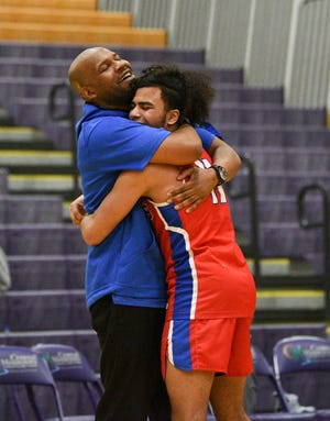 Apollo head coach Jason Allen and senior Michael Gravelle hug after a winning the Section 8AAA championship against Alexandria Thursday, March 12, 2020, at Melrose High School.