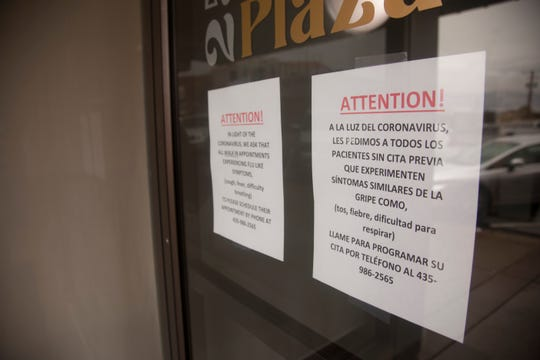 Signs on the doors of Family Healthcare in downtown St. George warn patrons of COVID-19 symptoms Friday, March 13, 2020.