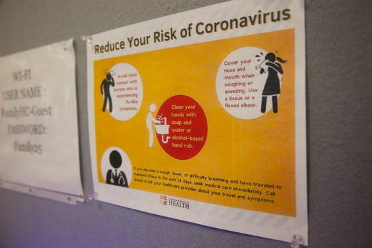 Signs in the lobby of Family Healthcare in downtown St. George demonstrate methods to defend against COVID-19 Friday, March 13, 2020.