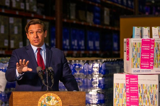 Gov. Ron DeSantis holds a press conference at the Department of Health to inform the public that coronavirus test kits have arrived to Florida, Friday, March 13, 2020.