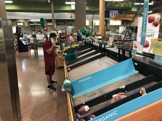 The produce section of this Publix in Viera, Florida, is nearly empty. Local officials are asking people to keep others in mind before overstocking on supplies.
