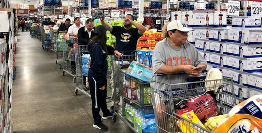 Shoppers line up from the back of the Sam's Club at 11360 Pellicano Dr., in East El Paso, to the check stands on March 13 as most baskets had packs of water and paper towels that were being rationed as supplies ran out due to coronavirus fears.