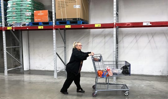 Shopper passes by a bare area where toilet paper sold out at the Sam's Club at 9498 Gateway North Blvd., in Northeast El Paso. Coronavirus fears have wiped out inventory of toilet paper and cleaning products at many El Paso area stores.
