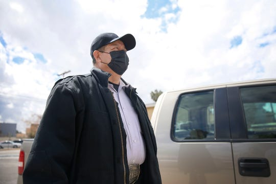 Roberto Ruiz wears a face mask in the Segundo Barrio neighborhood Friday, March 13, in El Paso. Ruiz said he was wearing the face mask because of allergies but he realizes other people are wearing them as a precaution in response to the COVID-19 coronavirus.