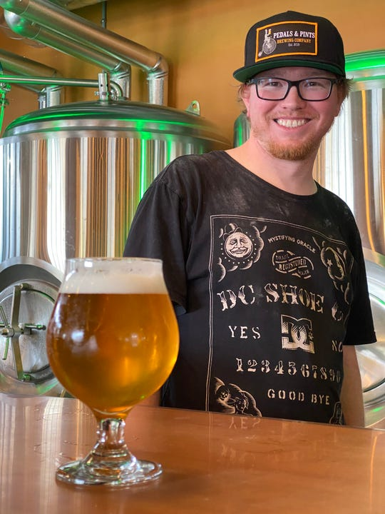 David Chaney, head brewer at Pedals & Pints Brewing Co. in Thousand Oaks, poses with an American pale ale he made for the brewery's grand opening.
