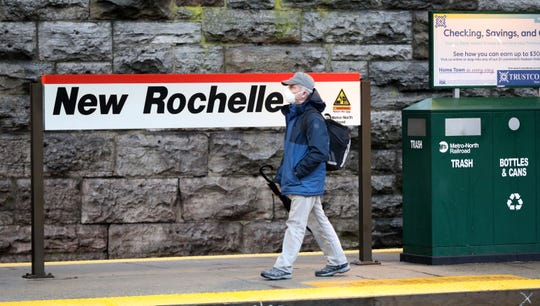 A train commuter wears as mask as he waits on the Stamford bound platform at the New Rochelle Train Station, March 13, 2020.