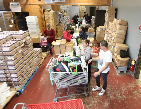 Volunteers pack bags of non-perishable goods donated by Stop & Shop at the Hope Community Food Pantry in New Rochelle on Friday, March 13, 2020.  Food will be delivered to senior centers and can be picked up as well.
