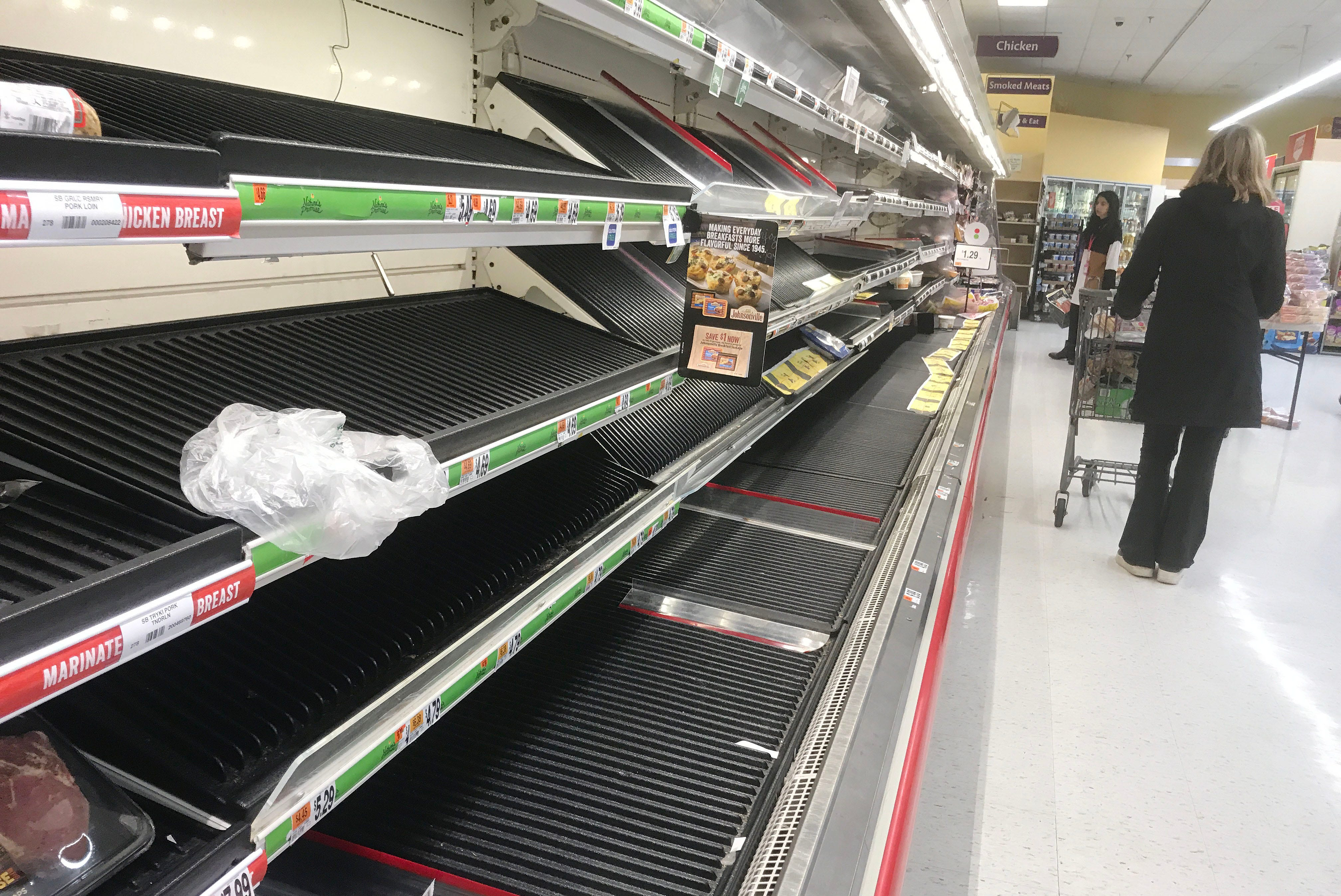 As COVID-19 swept the state and schools and businesses closed their doors, grocery stores scrambled to restock, limiting their hours and putting stockpiling limits on dozens of grocery items to alleviate scenes like this one, where shoppers saw empty meat shelves at the Stop & Shop in Mamaroneck on March 13, 2020.