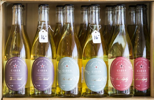 A selection of Castle Hill ciders sit on display at Moore Brothers Wine Co. in Wilmington.