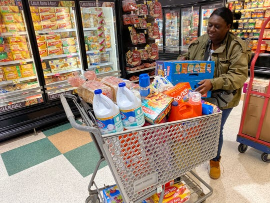 Ebony Miller stocks up at the ShopRite in south Wilmington amid coronavirus concerns.