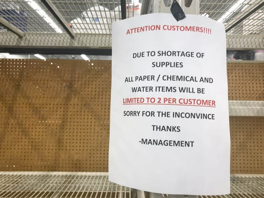 Shelves usually full of toilet paper sit empty at the Walmart in New Castle on Friday, as locals stock up on supplies amid coronavirus concerns. Signs hang to tell shoppers they much limit purchases of certain items.