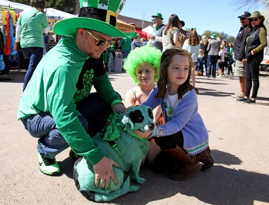Toby McClain and rescue dog Bandy meet Channing Davis and Harper Davenport, right, during the 2019 St. Patrick's Day Festival   in downtown Wichita Falls.