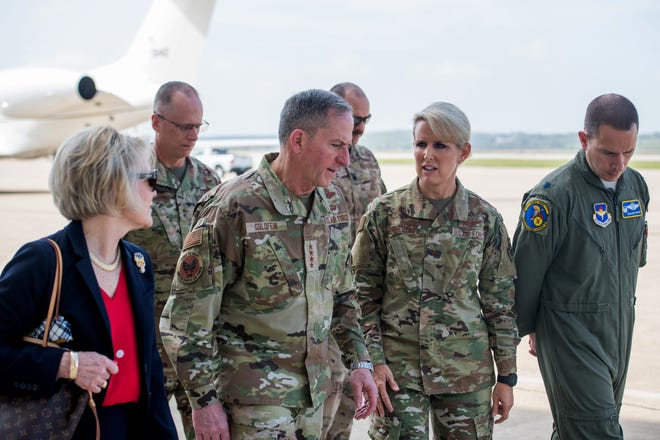 U.S. Air Force Chief of Staff, Gen. David L. Goldfein (center), and his wife, Dawn (left), meet Brig. Gen. Laura Lenderman (right),  502nd Air Base Wing and Joint Base San Antonio commander, during a visit at JBSA-Lackland, Texas, March 11, 2020, to observe and discuss current operations surrounding COVID-19.