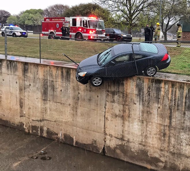The driver of this Honda escaped serious injury after being involved in an accident on Midwestern Parkway near Seabury about 5:20 pm Friday. A chain link fence stopped the vehicle from plunging into McGrath Creek.