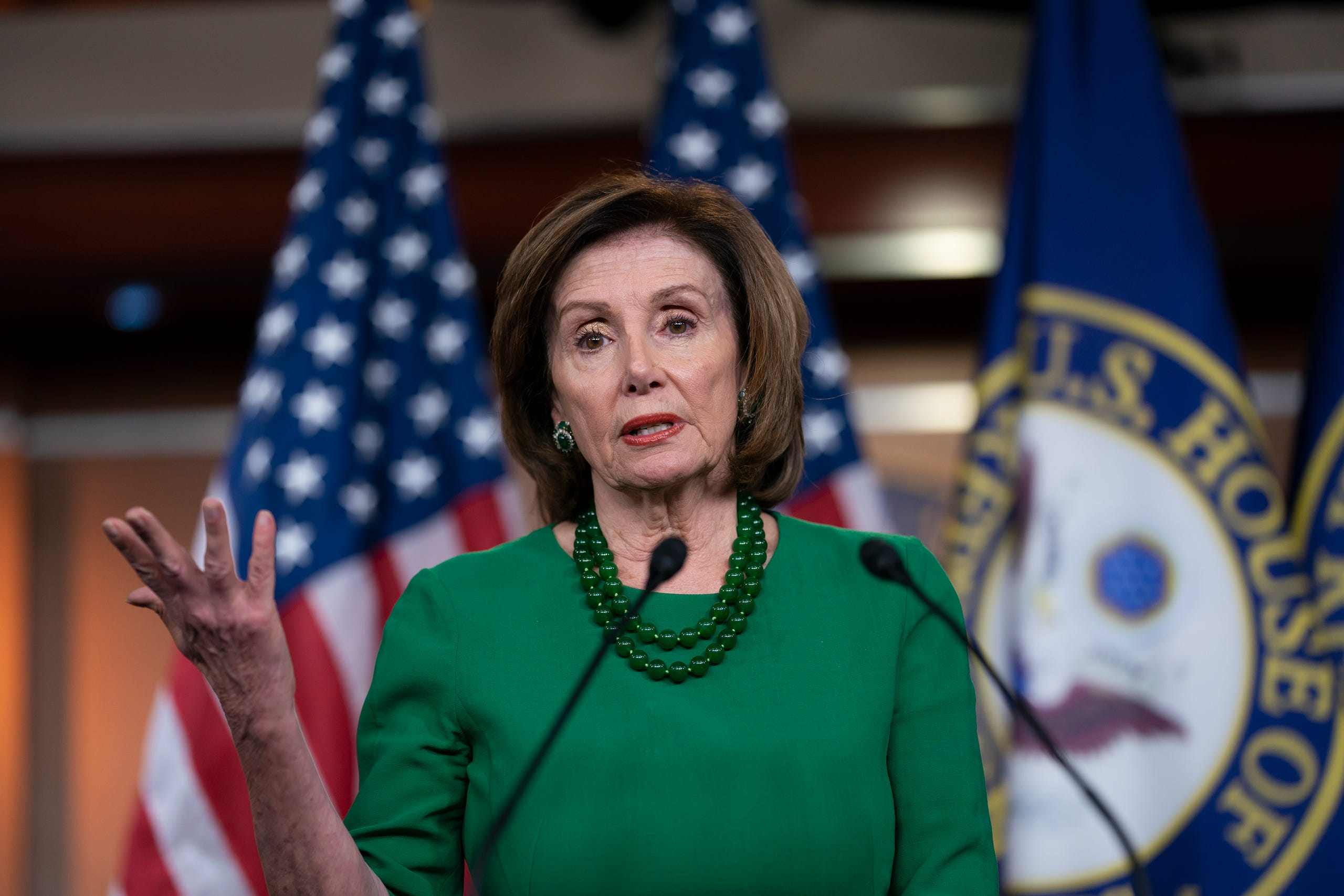 House Speaker Nancy Pelosi, D-Calif., updates reporters as lawmakers worked on a coronavirus aid package in Washington on Thursday.