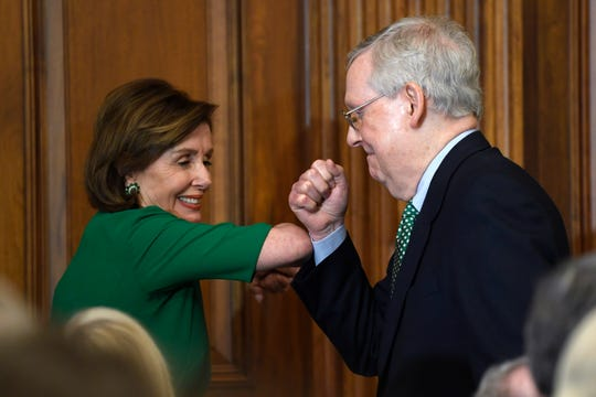 House Speaker Nancy Pelosi of Calif., left, and Senate Majority Leader Mitch McConnell of Ky., right, bump elbows as they attend a lunch with Irish Prime Minister Leo Varadkar on Capitol Hill in Washington, Thursday, March 12, 2020.