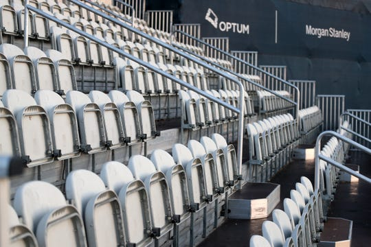 Seats are seen vacant in a grandstand after the cancellation of the The PLAYERS Championship and three consecutive events due to the COVID-19 pandemic at The Stadium Course at TPC Sawgrass on March 13, 2020 in Ponte Vedra Beach, Fla.