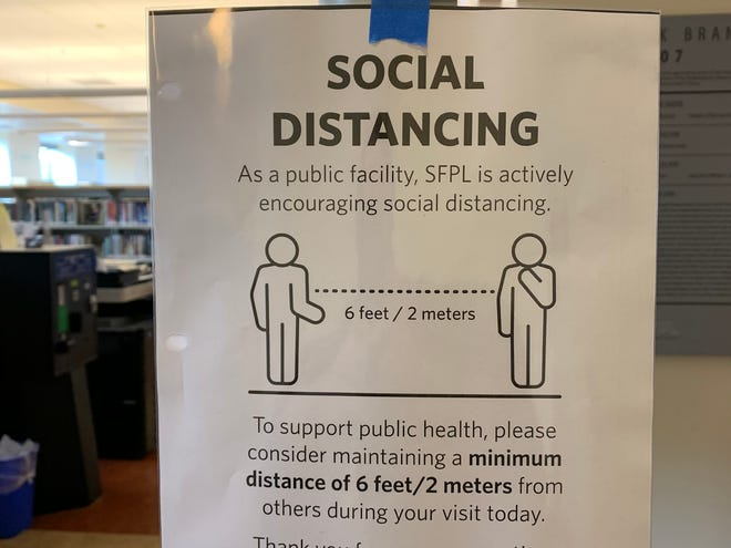 A sign at the Glen Park branch of the San Francisco Public Library on Friday, March 13, 2020. The library system locked its doors at 6:00 pm March 13 in order to slow the spread of the coronavirus. It is set to reopen on March 31.