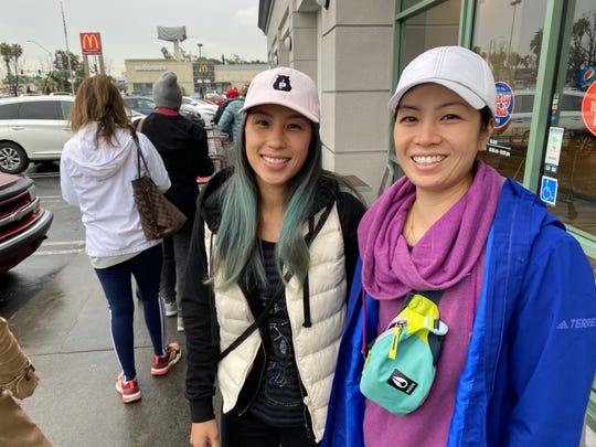 Jolene and Christine Chan wait in line at a Costco in Lawndale, California