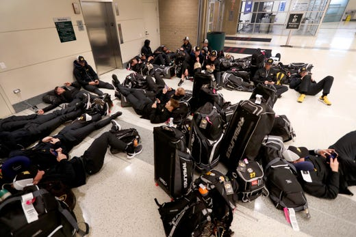Players with the University of Missouri baseball team wait in the baggage claim area of Chicago's Midway Airport Thursday, March 12, 2020, only to arrive in Chicago and then get notified that the team's SEC Conference opener with Alabama Friday, had been canceled.