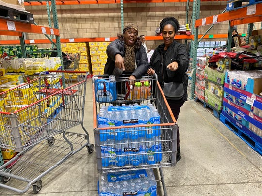 Chiquita Thursby and Yordano Tesfailasce waited one hour to get their allotted two cases of water at a Costco in California