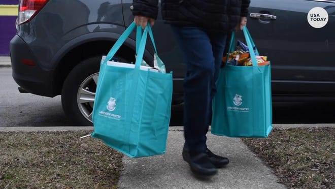 Volunteers deliver meals to the homes of quarantined students who attend a school for children with significant disabilities on Chicago's north side.