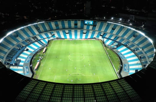 Peru's Alianza Lima and Argentina's Racing Club play a Copa Libertadores soccer match at the Presidente Peron stadium in Buenos Aires, Argentina, Thursday, March 12, 2020. The match was played in an empty, closed door stadium as part of the government's measures to contain transmission of the new coronavirus.