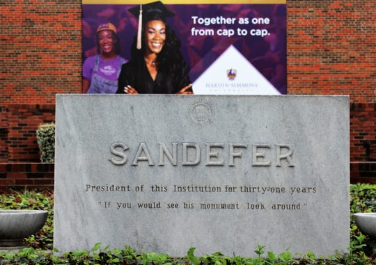 The gravestone for Jefferson Davis Sandefer, the sixth president of Hardin-Simmons University, can be viewed with others near the campus student center.