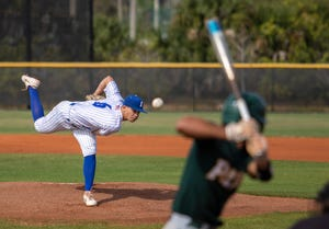 Jackson Wooward pitches for Eastern Florida State. Photo by Mike Brown.