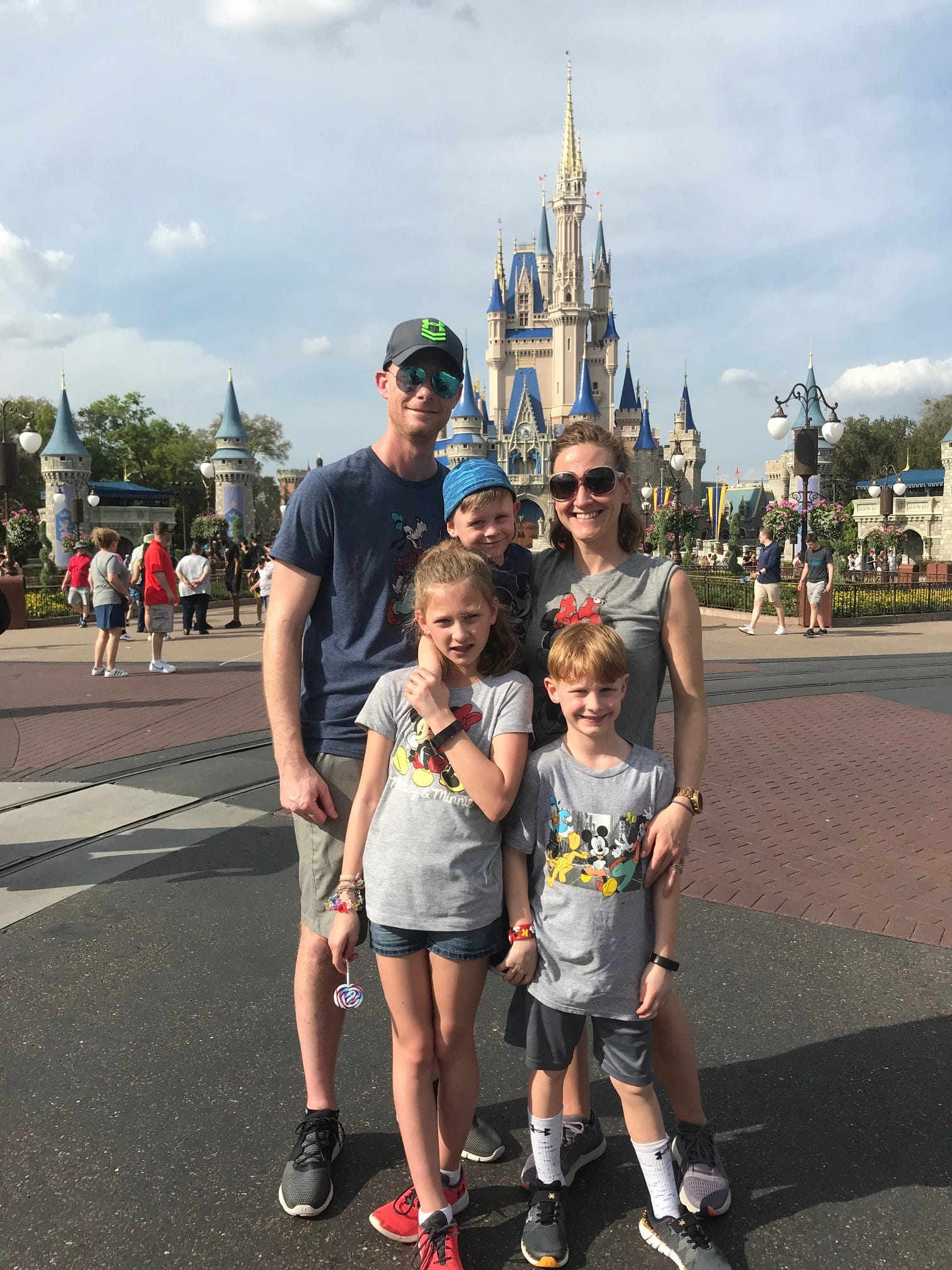 Meghan and Tim Consdorfand their children -- Ashley, 10, Luke, 9, and Tyler, 4 -- visit Magic Kingdom on March 13. The couple said they considered their options for the planned trip after the spread of the coronavirus, but opted to stick with their plans and take all the steps they could to wash up well and often.