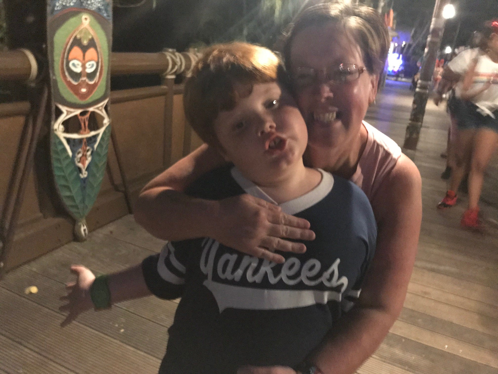 Debbie Seuffer-Wright and her son, Finn, share a smile outside Adventureland at Magic Kingdom on the last Friday night the park will be open this month. All Disney parks are closed through March 31 over concerns about the worldwide pread of the coronavirus.