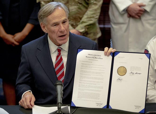 Texas Gov. Greg Abbott issues a disaster declaration in response to the growing threat of the novel coronavirus on Friday, March 13, 2020, in Austin, Texas.