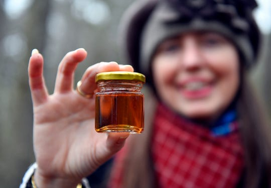 Professor of Mathematics Judith Vogel holds a jar of maple syrup processed on her family farm. Vogel is a member of the Stockton University team tasked to promote maple sugaring in the South Jersey region through research and community outreach.
