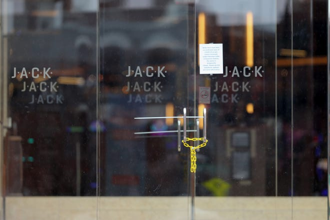 The doors to the Jack Cincinnati Casino are locked, as a sign posted on the door indicates they have closed as a result of the new coronavirus outbreak, Saturday, March 14, 2020, at the Hamilton County Board of Elections in Cincinnati, Ohio.