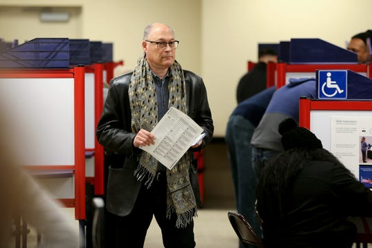 Voters take advantage of early voting, Saturday, March 14, 2020, at the Hamilton County Board of Elections in Norwood, Ohio.
