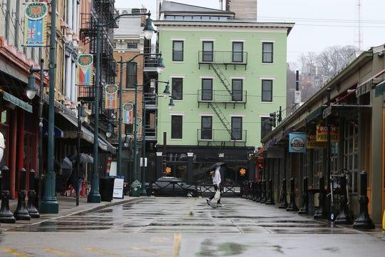 A shopper walks through Findlay Market on a rainy day, Saturday, March 14, 2020, in Cincinnati, Ohio.